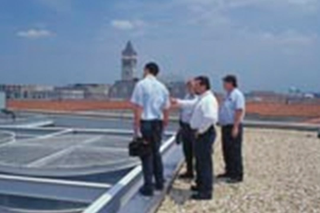 Engineers on a building rooftop
